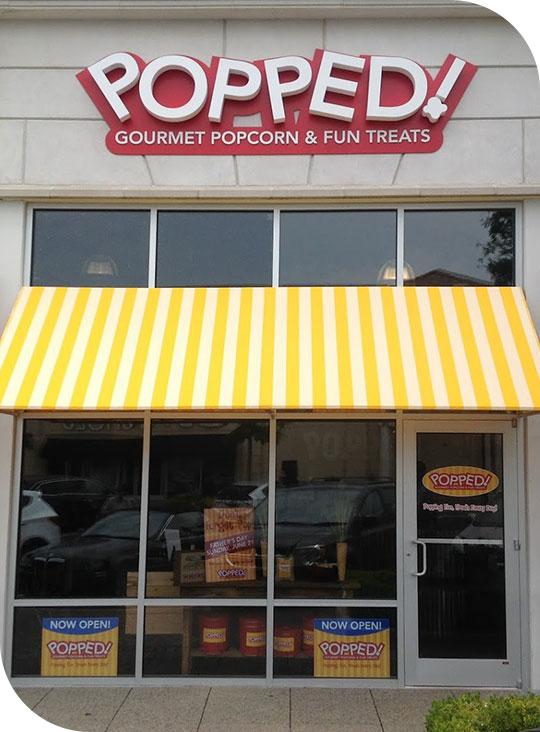 custom awning outside Popped! Gourmet Popcorn & Fun Treats